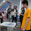 Graphic Arts students wait patiently as Kyle Recknagel (right), completes a screen print on his t-shirt at Privation Printing Thursday, April 17, 2014. Students in Cheryl Cooksey's graphic arts classes at Autry Technology Center created shirt designs and learned the screen print process from Timothy Larsen (right), owner of Privation Printing, an incubator company in the James W. Strate Center for Business Development at 2020 Willow Run Street. (Staff Photo by BONNIE VCULEK)