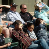 Baseball fans shield their eyes from the sun as they watch the Pioneer Mustangs and Oklahoma Bible Academy Trojans play during the Merrifield Office Plus Invitational at David Allen Memorial Ballpark Friday, April 18, 2014. (Staff Photo by BONNIE VCULEK)