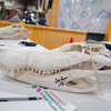 Two 10' alligator skulls, from gators caught by Queen Liz and Snagger Jessica, and two cell phone cases made from alligator feet are silent auction items available to the highest bidder. Proceeds from the auction will go to St. Jude's Children's Hospital during the 39th annual Enid Home Show. (Staff Photo by BONNIE VCULEK)