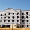 Construction continues on the new Home Away Suites, 5103 W. Owen K. Garriott, Thursday, April 9, 2015. (Staff Photo by BONNIE VCULEK)