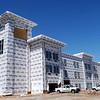 Construction continues on the new La Quinta Inn & Suites at 4914 W. Owen K. Garriott Thursday, April 8, 2015. (Staff Photo by BONNIE VCULEK)
