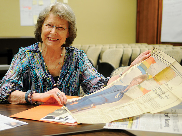 Willa Jo Fowler recalls information in a previous Enid News & Eagle Sunday Front profile as she shares experiences from her 40 years of service on the Enid Public Schools' Board of Education Wednesday, April 1, 2015. (Staff Photo by BONNIE VCULEK)