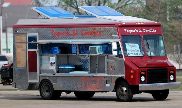Taqueria El Carnitas, a local food truck, parks along E. Owen K. Garriott Thursday, April 8, 2015. (Staff Photo by BONNIE VCULEK)