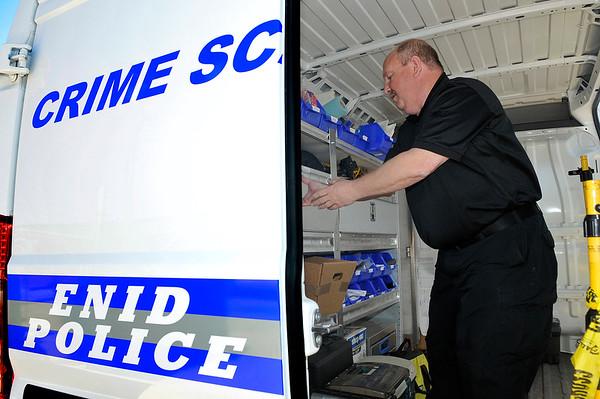 Tim Hess, Enid Police Department crime scene technician, inside crime scene van April 7, 2016. (Billy Hefton / Enid News & Eagle)