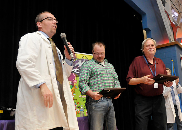 Drew Ritchie (left) talks about Chisholm Elementary teachers, Roy Bartwick (center) and Tim Braley, after presenting them with a certificate of appreciation at Chisholm Elementary Thursday April 14, 2016. (Billy Hefton / Enid News & Eagle)