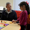Curt Gilbertson works with Janeth Gonzalez at the Carver Early Childhood Center Wednesday April 5, 2017. (Billy Hefton / Enid News & Eagle)