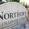 Cesar Garcia works to repair the damaged Northern Oklahoma College sign April 18, 2017. The sign was damaged last fall. (Billy Hefton / Enid News & Eagle)