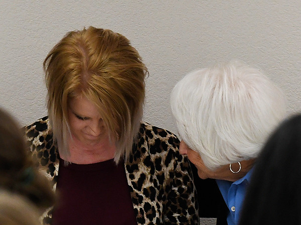 Amy Deeds (left) is comforted by Carole Wade after giving the keynote address during the 26th Annual Crime Victims' Vigil Tuesday April 4, 2017 at the YWCA Enid. (Billy Hefton / Enid News & Eagle)