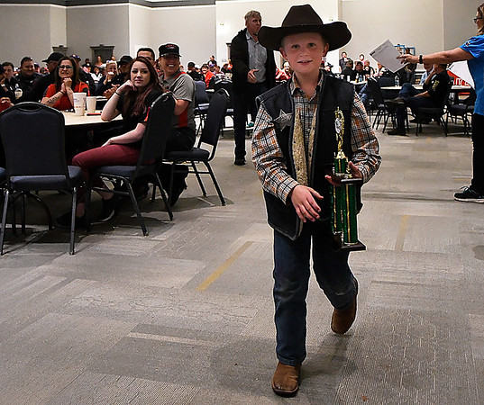 Jayden Stoddard walks with Kid's Q first place trophy during the awards ceremony for the 12th Smokin' Red Dirt BBQ Saturday April 22, 2017 at the Central National Bank Center. (Billy Hefton / Enid News & Eagle)