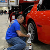 Bill Immell polishes a the wheel of his 2002 Z 06 Coup Corvette during the Enid Corvette Expo Saturday April 1, 2017 at the Chisholm Trail Expo Center. (Billy Hefton / Enid News & Eagle)