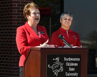 NWOSU Enid Dean, Dr. Wayne McMillin, listens to NWOSU President, Dr. Janet Cunningham, during a ceremony Tuesday April 11, 2017 marking the 20th anniversary of the NWOSU Enid campus. (Billy Hefton / Enid News & Eagle)