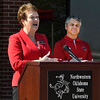 NWOSU Enid Dean, Dr. Wayne McMillin, listens to NWOSU President, Dr. Janet Cunningham, during a ceremony Tuesday April 11, 2017 marking the 20th anniversary of the NWOSU Enid campus. (Billy Hefton / Enid News & Eagle)