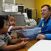 Steve Wagner works with Ikailea Libokmeto and Wilkinson Matin at the Carver Early Childhood Center Wednesday April 5, 2017. (Billy Hefton / Enid News & Eagle)