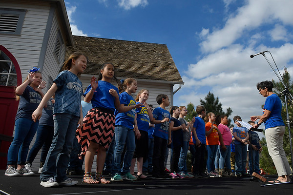The Taft Elementary 3rd grade choir performs during the Event sponsored by the Enid Public School Foundation Monday April 30, 2018 at Humphrey Heritage Village. (Billy Hefton / Enid News & Eagle)