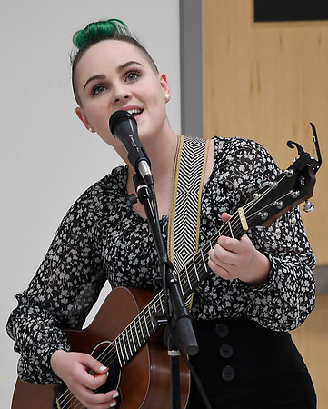 Chloe-Beth Campbell performs during the 27th Crime Victim's Vigil Tuesday April 10, 2018 at the YWCA Enid. (Billy Hefton / Enid News & Eagle)