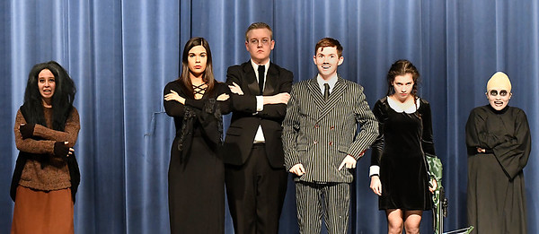 """(Left to right) Brigitte Goulart (Grandma Addams), Ashton Davis (Morticia Addams), Chandler Cravens (Lurch), Nolan Riggin (Gomez Addams), Baylee Fitzgerald (Wednesday Addams) and Kalina Collins (Fester Addams) of the Enid High production of """"The Addams Family"""" Wednesday April 18, 2018. (Billy Hefton / Enid News & Eagle)"""