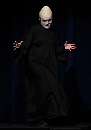 "Kalina Collins (Fester Addams) rehearses during the Enid High production of ""The Addams Family"" Wednesday April 18, 2018. (Billy Hefton / Enid News & Eagle)"