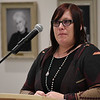 Tonia Byers tears up as she tells her story during the 27th Crime Victim's Vigil Tuesday April 10, 2018 at the YWCA Enid. (Billy Hefton / Enid News & Eagle)