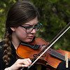 Emily Honeycutt of the Waller Middle School orchestra plays the violin during the Event sponsored by the Enid Public School Foundation Monday April 30, 2018 at Humphrey Heritage Village. (Billy Hefton / Enid News & Eagle)