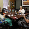 (left to right) Bettye Wines, Martha Robberson, Maxine Lansdown and Eva Smith play a game of cards at the Commons Monday April 30, 2018.(Billy Hefton / Enid News & Eagle)