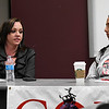 Casey-Camp Horinek (right), of the Ponca tribe, listens to Candace Reim, who is independently contracted with Public Service Company of Oklahoma's Wind Catcher Energy Connection, during a panel discussion on wind engery in northwest Oklahoma Thursday April 19, 2018 at NWOSU Enid. (Billy Hefton / Enid News & Eagle)