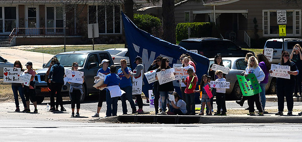 Enid teachers and kids at the intersection of Garriott and Van Buren on the fourth day of the teacher walkout April 5, 2018. (Billy Hefton / Enid News & Eagle)