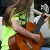 Emily Kinney of the Longfellow Middle School guitar club performs during the Event sponsored by the Enid Public School Foundation Monday April 30, 2018 at Humphrey Heritage Village. (Billy Hefton / Enid News & Eagle)