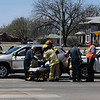 Enid emergency personnel tend to a driver involved in an accident at the intersection of Broadway and Van Buren Thursday April 5, 2018. (Billy Hefton / Enid News & Eagle)