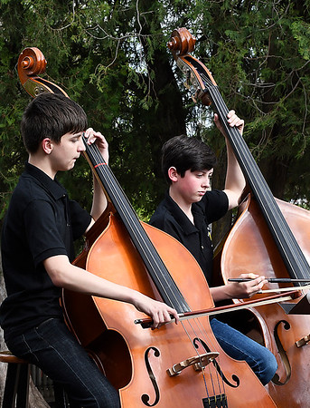 Wyatt Wilson and R.J. Harris of the Waller Middle School orchestra play the bass during the Event sponsored by the Enid Public School Foundation Monday April 30, 2018 at Humphrey Heritage Village. (Billy Hefton / Enid News & Eagle)