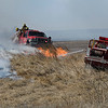 Brush rigs from Enid and Kemlin work a grass fire north 30th street Monday March 5, 2018. (Billy Hefton / Enid News & Eagle)