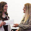 Jenny Grittman (left), from the Junior Welfare League of Enid, presents Janna Jackson, of the Enid Public Schools Foundation, with a check during a monthly meeting at the Stride Bank Center Monday April 1, 2019. (Billy Hefton / Enid News & Eagle)