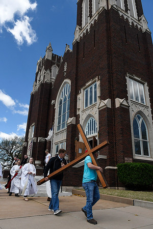 A processional leaves the First Presbyterian Church as part of the Enid Ecumenical Good Friday service. (Billy Hefton / Enid News & Eagle)