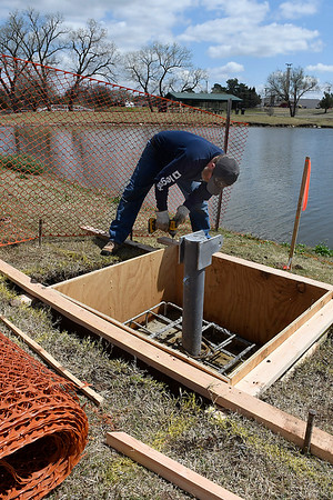 Scott Van Kirk, from Henson Construction, works on the footings for the boat dock anchors at Meadowlake Park Thursday April 4, 2019. The  dock is expected to be finished this summer. (Billy Hefton / Enid News & Eagle)