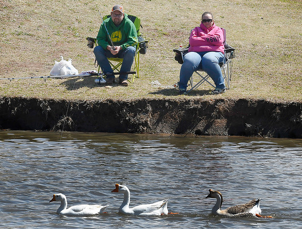 Billy Jones and Molly Buzzard spend a sunny afternoon at Meadowlake Park Monday April 1, 2019. (Billy Hefton / Enid News & Eagle)