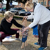 Judy Mason and Karen Foster place one of the 332 wooden children on the Garfield County Courthouse lawn Monday April 1, 2019. The Garfield County Child Advocacy Council sponsors the event where wooden children are placed on the courthouse lawn representing the abused children in the county last year. (Billy Hefton / Enid News & Eagle)