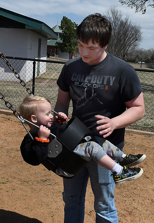 Jon Shanks spends time at a Meadowlake Park playground with his son, Jon, April 1, 2019. (Billy Hefton / Enid News & Eagle)