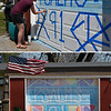 Danielle Kifer uses chalk to write a scripture verse on her garage door Tuesday, April 7, 2020. (Billy Hefton / Enid News & Eagle)