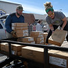 Will Gungoll carries boxes of food as Christy Baker stacks them on a trailer Wednesday, April 1, 2020. Tyson Foods donated a truck load of food to RSVP who distributed to food to non profits in northwest Oklahoma. (Billy Hefton / Enid News & Eagle)