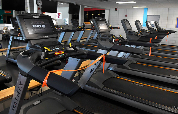 Orange tape was placed on treadmills at the Denny Price Family YMCA Thursday, April 30, 2020 to ensure social distancing. The YMCA is planning to open by appointment Monday, May 4. (Billy Hefton / Enid News & Eagle)