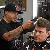 Cisco Martinez styles the hair of Garrett Hamm Wednesday, April 7, 2021 at his shop, Perfect Style Hair Studio. (Billy Hefton / Enid News & Eagle)
