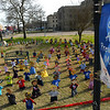 As part of Child Abuse Prevention Month the Garfield County Child Advocacy Council places wooden kid figures on the lawn of the Garfield County Courthouse respresenting the number of child abuse cases in 2020. (Billy Hefton / Enid News & Eagle)