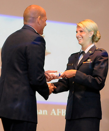 2nd Lt. kayla Bowers receives her diploma from Col. Darren James during graduation ceremonies for Joint Specialized Undergraduate Pilot Training Class 13-13 Friday at vance Air Force Base. (Staff Photo by BILLY HEFTON)