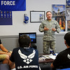 T.Sgt. Luis A. Davila, Sr., from the United States Air Force recruiting office at 705 S. Oakwood Avenue in Enid, works with several of his recruits Thursday, August 1, 2013.  T.Sgt. Davila is pleased with the progress that has been made since the local Air Force recruiting office was re-opened a year ago after being closed for five years. A Heroes Wall (top left) features area recruits that have completed basic training with T.Sgt. Davila's mentoring. (Staff Photo by BONNIE VCULEK)