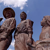 Harold T. Holden's sculpture, The Homesteaders, stand against a warm August sky Monday. (Staff Photo by BILLY HEFTON)