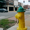 Traffic moves past a fire hydrant at 302 N. Independence Thursday, August 8, 2013. New fire flow policies were presented by Enid Fire Department Fire Marshall Ken Helms in response to the low, water pressure scare Thursday, August 8, 2013. (Staff Photo by BONNIE VCULEK)