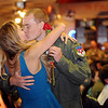 2nd Lt. Alex Horn kisses his wife after learning his aircraft assignment for Class 13-13 at Vance Air Force Base Friday, August 2, 2013. (Staff Photo by BONNIE VCULEK)