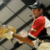 Jason Reynolds, from Fetch-N-Fish Promotions in Checotah, Okla., holds a giant snapping turtle during a noodling demonstration at the Greater Oklahoma Sportsman's Outdoor Expo at the Chisholm Trail Expo Center Saturday, August 24, 2013. (Staff Photo by BONNIE VCULEK)