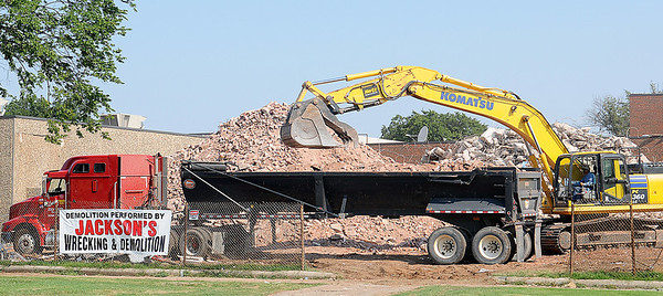 Jackson's Wrecking & Demolition continue the debris removal at the Old Garfield Elementary School location on E. Broadway Tuesday, August 20, 2013. The area will become a new green space and entrance for Longfellow Middle School. (Staff Photo by BONNIE VCULEK)