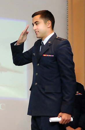 2nd Lt. Ryan Schieber salutes Col. Darren James after receiving his diploma during graduation ceremonies for Joint Specialized Undergraduate Pilot Training Class 13-13 Friday at vance Air Force Base. (Staff Photo by BILLY HEFTON)