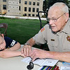 Deputy Grant Hopkins fingerprints Timothy Eckels during the National Night Out event Tuesday at the Garfield County Courthouse. (Staff Photo by BILLY HEFTON)